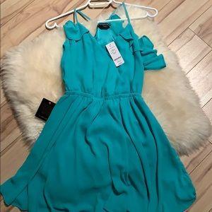 Bebe turquoise racer back v neck dress